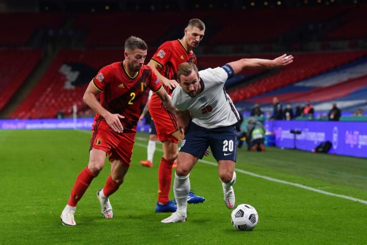 Harry Kane battling with clubmate Toby Alderweireld in England's recent meeting with Belgium