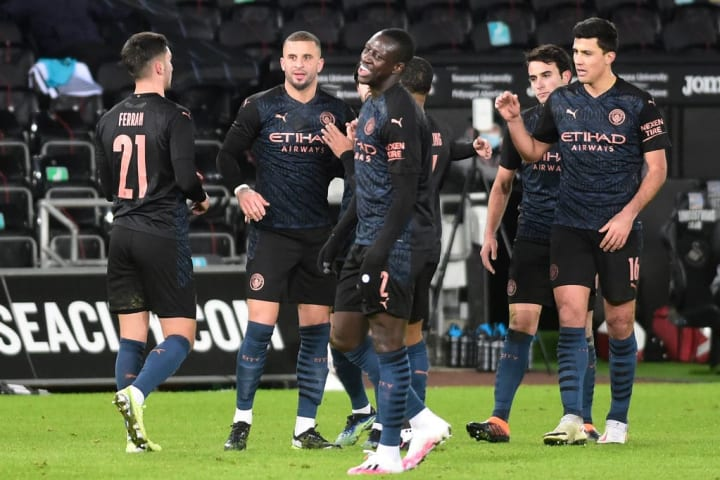 Current holders Manchester City beat Swansea to reach the quarter finals