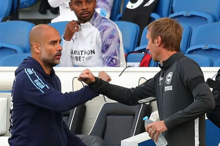 Potter and Guardiola embracing during Brighton's meeting with Manchester City during 2019/20