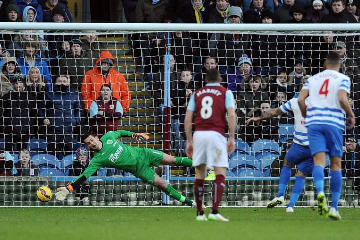 Heaton reaching unsuccessfully for a penalty against QPR
