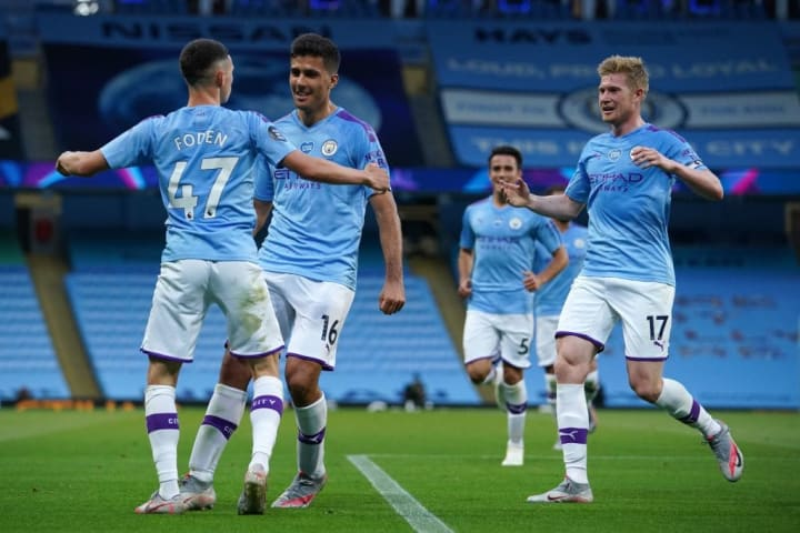 City celebrate their 4-0 thumping of Liverpool