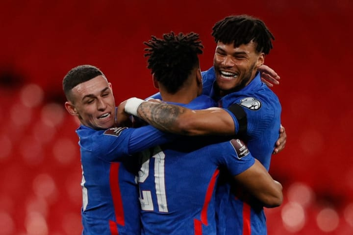 Tyrone Mings celebrates with Phil Foden and Ollie Watkins