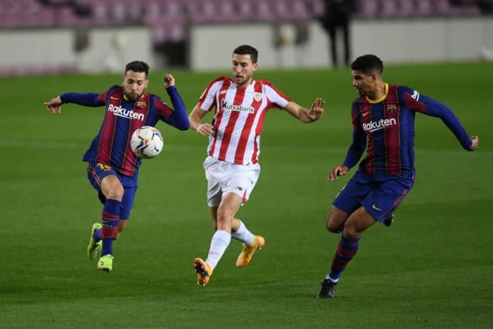 Alba fights for possession