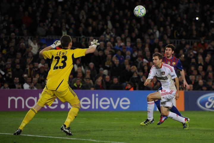 Barcelona's Lionel Messi lifts the ball over Bernd Leno of Leverkusen