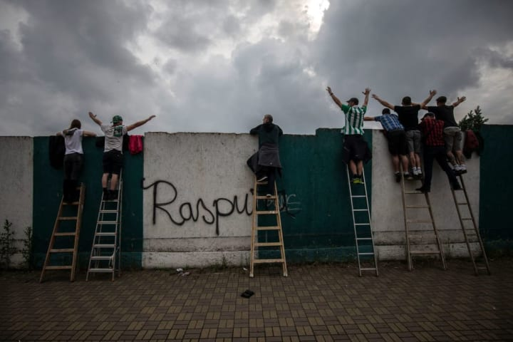 Fans Sneak A Glimpse As Bohemians 1905 Play FK Jablonec To Empty Stadium