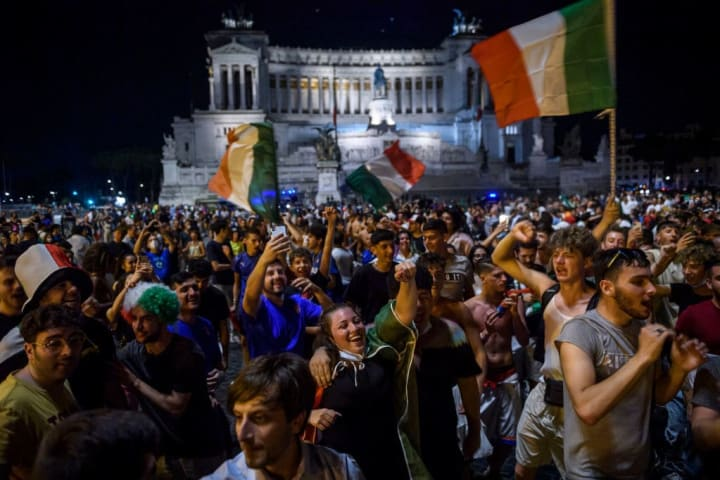 Football Fans In Rome Watch Italy Play Spain In EURO 2020