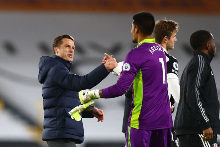 Areola embracing Fulham manager Scott Parker