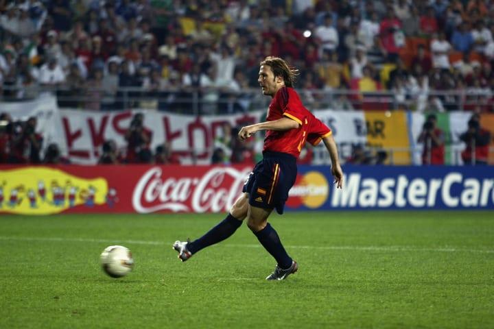 Gaizka Mendieta of Spain scores the winning penalty in the shoot-out