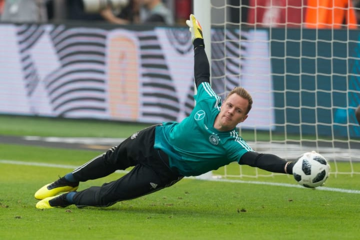 Marc-Andre ter Stegen trying his best to catch Low's attention in training (it's not working so far)