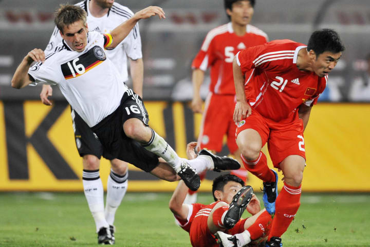 Germany's defender Philipp Lahm (L) vies