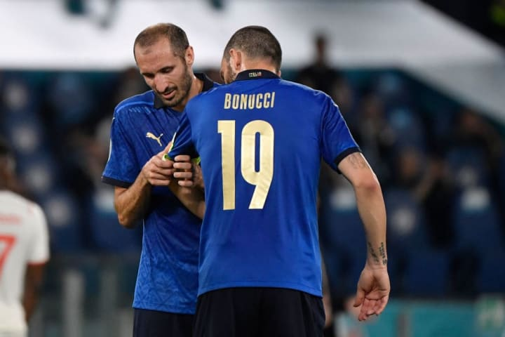 Giorgio Chiellini of Italy, injured, gives the captain arm...