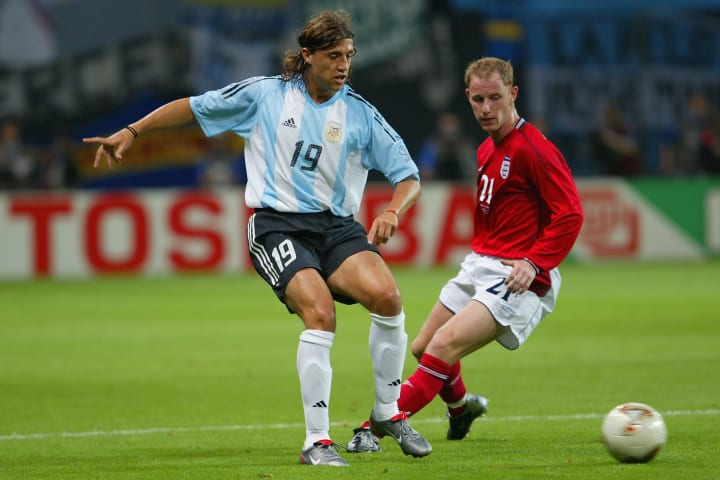 Hernan Crespo of Argentina and Nicky Butt of England
