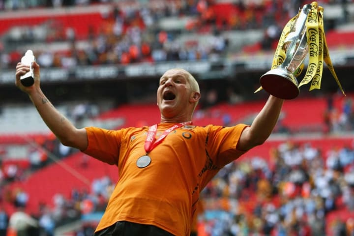 Dean Windass lifts the play-off trophy in front of the Hull fans
