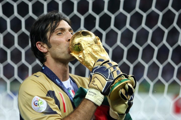 Buffon kisses the World Cup he won in 2006