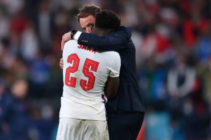 Bukayo Saka is consoled by Gareth Southgate