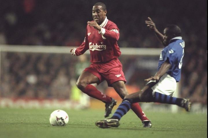 John Barnes of Liverpool (left) is challenged by Earl Barrett of Everton