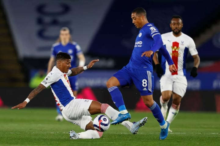 Crystal Palace's Patrick van Aanholt challenges Leicester's Youri Tielemans