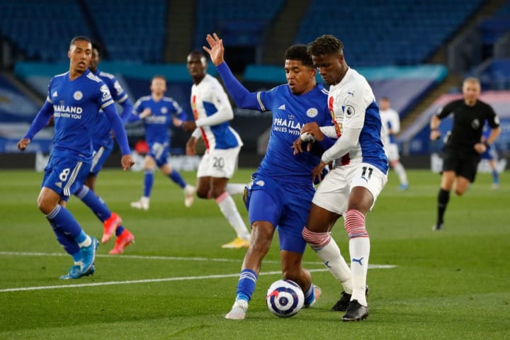 Leicester's Wesley Fofana battles with Crystal Palace's Wilfried Zaha