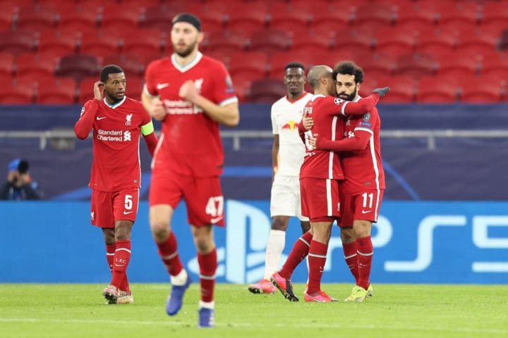 Mohamed Salah and Thiago celebrate as Liverpool beat RB Leipzig in their Champions League last 16 second-leg tie