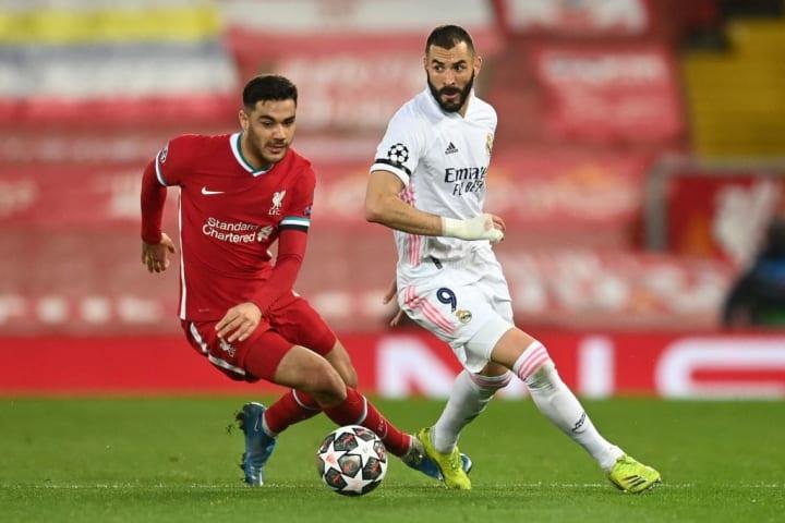 Ozan Kabak runs away from Karim Benzema