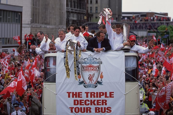 Liverpool celebrate winning the FA Cup, League Cup and UEFA Cup in 2001