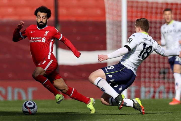 Liverpool's Mohamed Salah takes on Aston Villa's Matt Targett