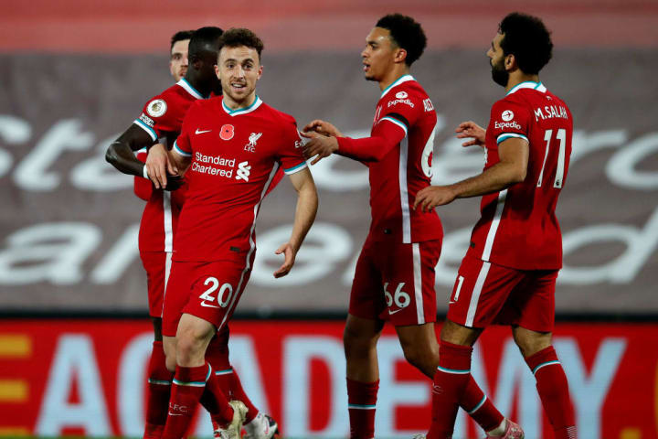 Liverpool players celebrate Diogo Jota's winning goal against West Ham
