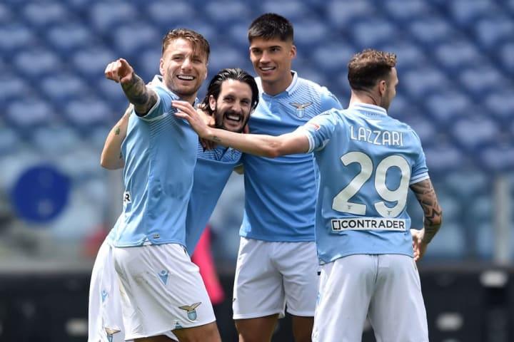 Luis Alberto of SS Lazio celebrates with Joaquin Correa,...