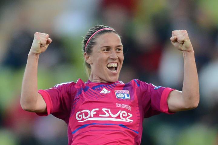 Lyon midfielder Camille Abily celebrates