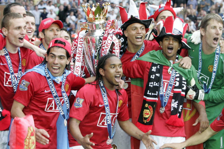 Manchester United players celebrate with