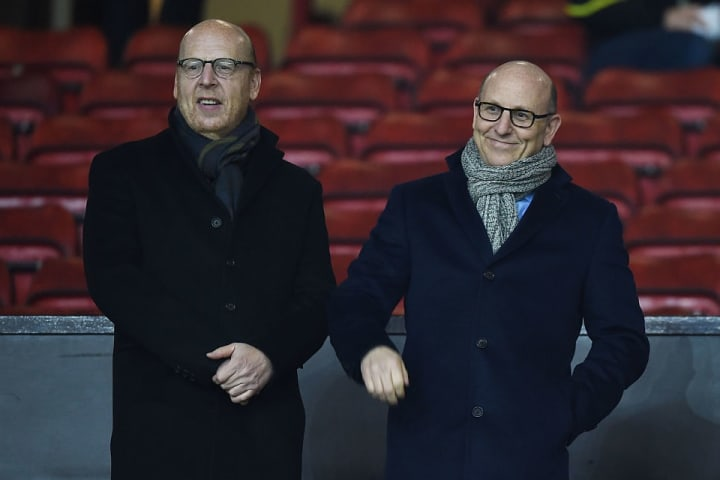 Joel Glazer (R) has vowed to win back trust he never had
