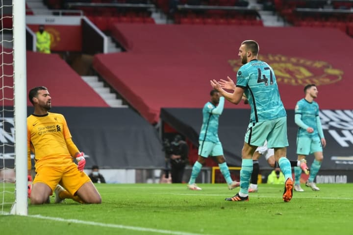Nathaniel Phillips diverts the ball past Alisson