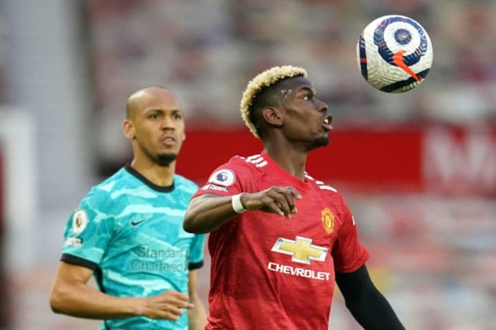 Paul Pogba shields the ball