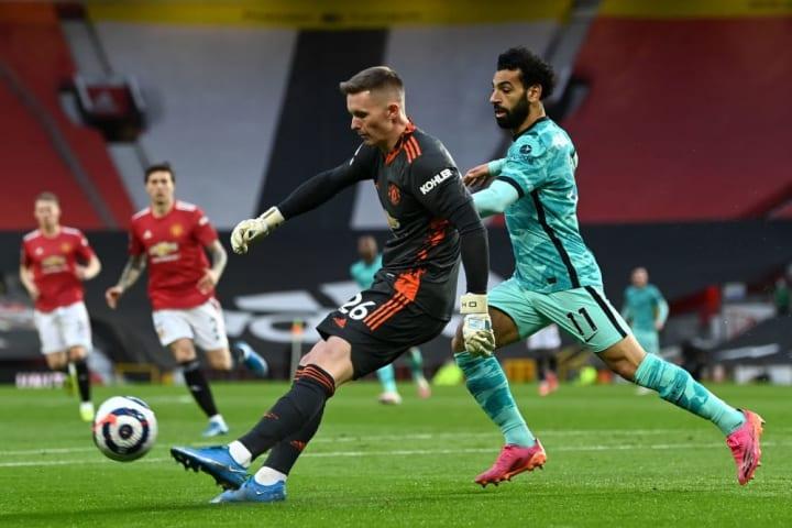 Dean Henderson clears under pressure from Mohamed Salah