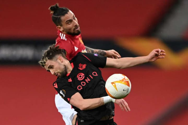Alex Telles leaps to win a header