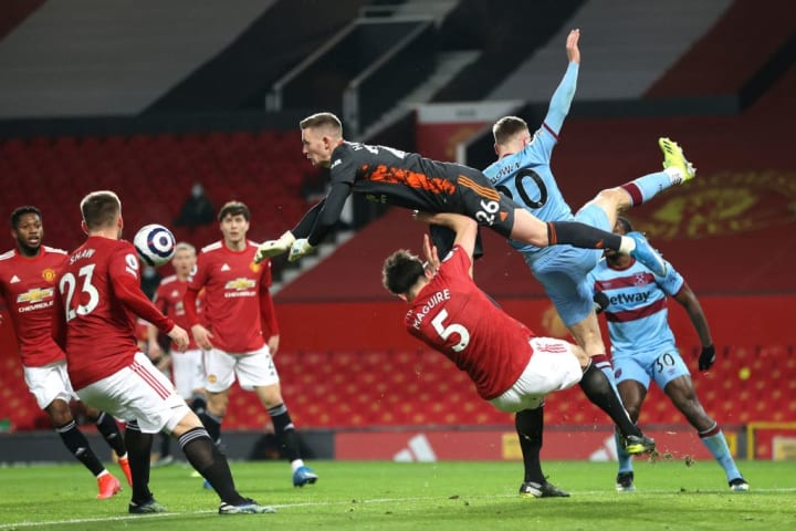 Dean Henderson leaves his line to pluck a West Ham cross out of the air