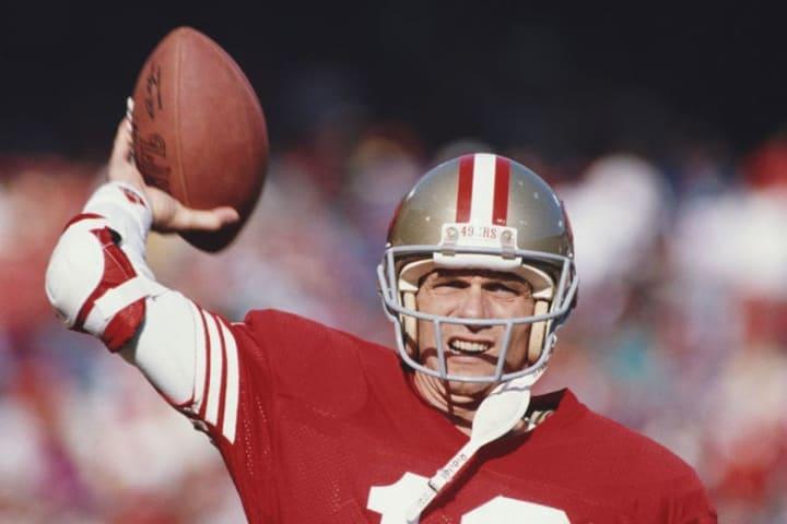 Former 49ers quarterback Joe Montana throws a pass.