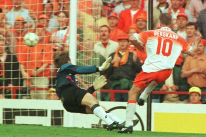 Netherland's Denis Bergkamp fires the ball past th