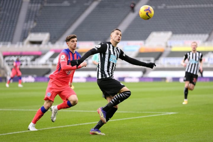 Javier Manquillo looks to clear the danger
