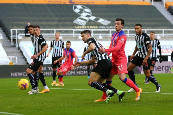 Federico Fernandez inadvertently steers the ball into his own net