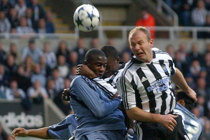Newcastle's Alan Shearer (R) heads the b