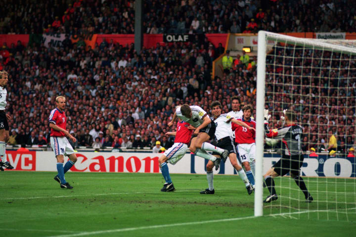 Oliver Bierhoff of Germany scores the equalising goal with a header