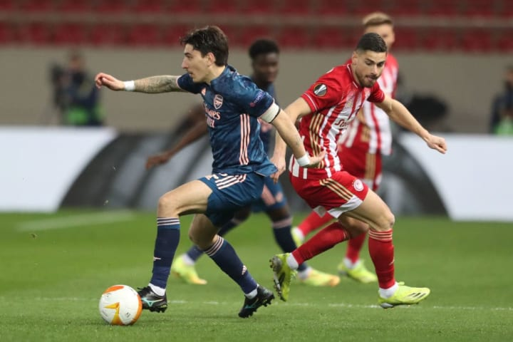 Arsenal's Hector Bellerin skips away from his man