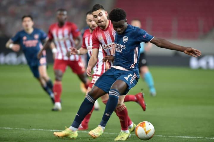 Bukayo Saka looks to wriggle away from Olympiacos' Giorgos Masouras