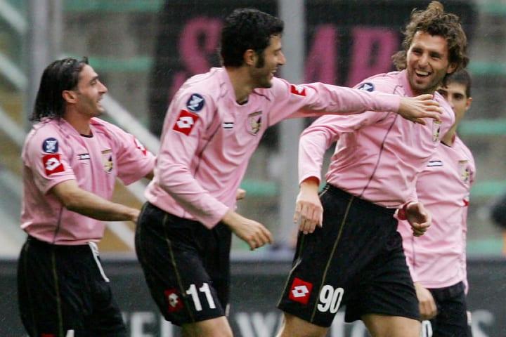 Palermo's forward Dennis Godeas (R) flan