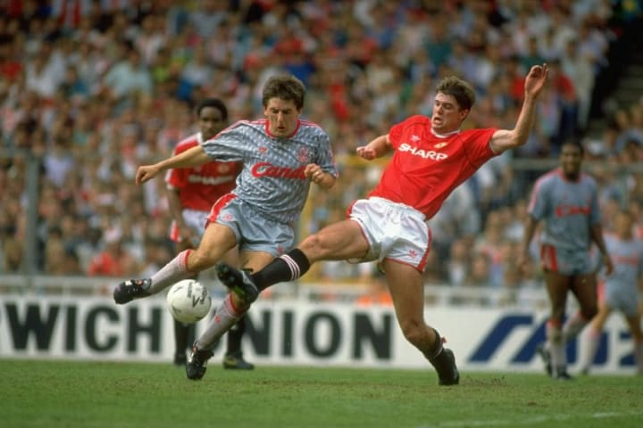 Peter Beardsley of Liverpool and Gary Pallister of Manchester United