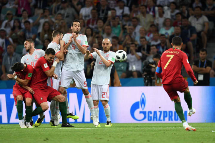 Ronaldo got the ball up and and down over the wall to complete a hat-trick and score his 84th Portugal goal