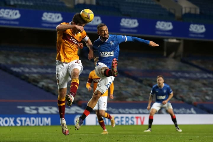 Gallagher goes up against Kemar Roofe