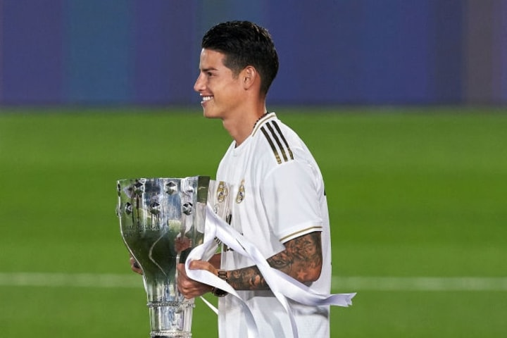 Rodríguez with the La Liga trophy after winning it with Real Madrid.