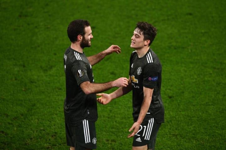 Daniel James celebrates with Juan Mata